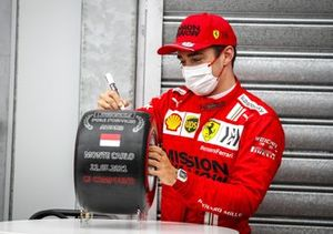 Charles Leclerc, Ferrari, signs the Pirelli Pole Position award