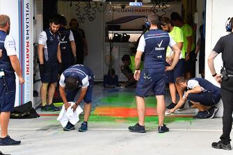 Williams mechanics clean aero paint from the garage floor