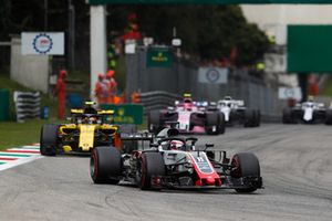 Romain Grosjean, Haas F1 Team VF-18, leads Carlos Sainz Jr., Renault Sport F1 Team RS 18, and Esteban Ocon, Racing Point Force India VJM11