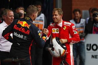Max Verstappen, Red Bull Racing, 3rd position, congratulates Sebastian Vettel, Ferrari, 1st position, in Parc Ferme