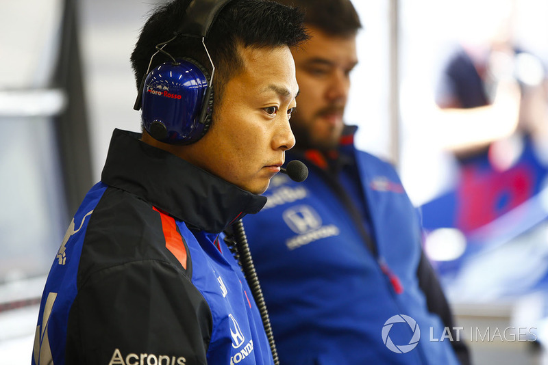 Honda employees at work in the Toro Rosso garage