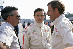 Lotus drivers Jim Clark and Graham Hill with Walter Hayes, public relations executive for Ford