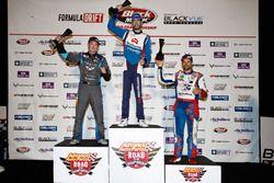 Podium: race winner James Deane, second place Dean Kearney, third place Kristaps Bluss
