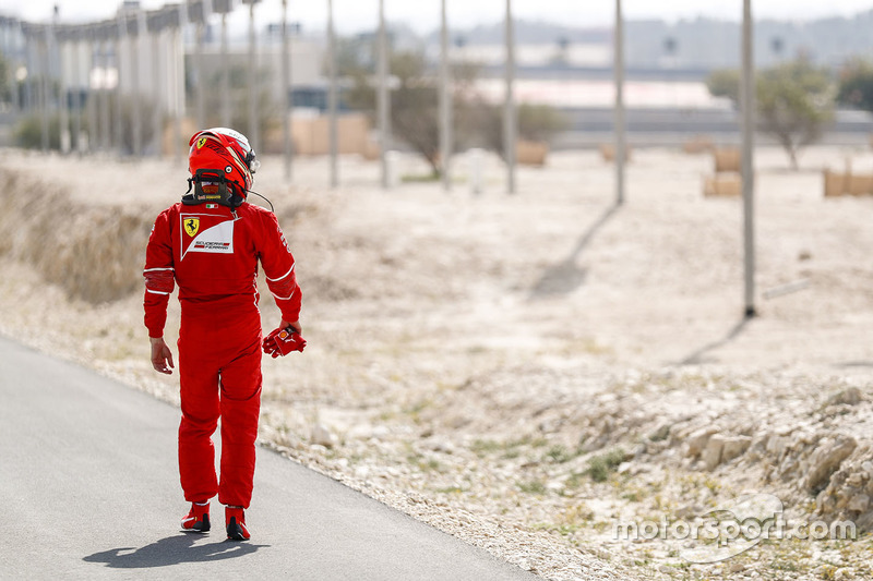 Kimi Raikkonen, Ferrari, heads back to the Ferrari garage