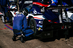 United Autosports team members at work