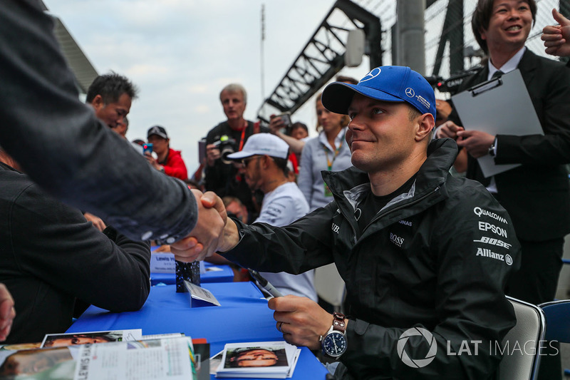 Valtteri Bottas, Mercedes AMG F1, signs autographs for the fans