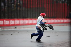 A marshall collects debris from the Sauber C35 of Marcus Ericsson, Sauber F1 Team