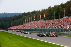 Lewis Hamilton, Mercedes AMG F1 W08, battles Sebastian Vettel, Ferrari SF70H, ahead of Valtteri Bott