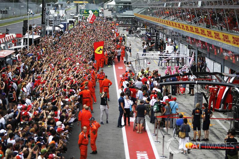 Fans in pit lane