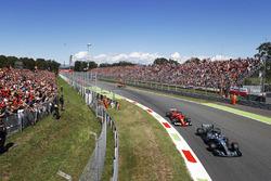 Valtteri Bottas, Mercedes AMG F1 W08, passes Kimi Raikkonen, Ferrari SF70H, in the Parabolica