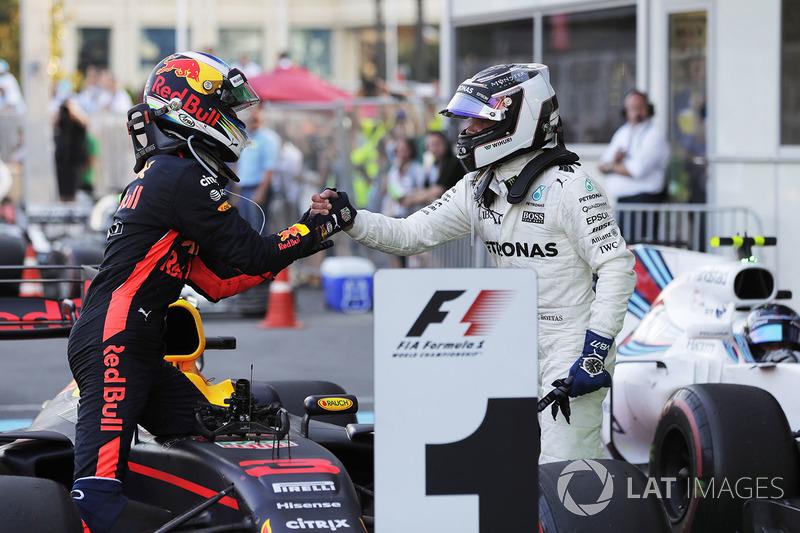 Valtteri Bottas, Mercedes AMG F1, congratulates Daniel Ricciardo, Red Bull Racing, on his victory in parc ferme