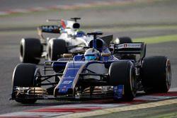 Marcus Ericsson, Sauber C36, leads Felipe Massa, Williams FW40