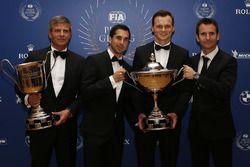 WEC-kampioenen van 2016 Neel Jani, Marc Lieb en Romain Dumas, en Fritz Enzinger, vice-president van