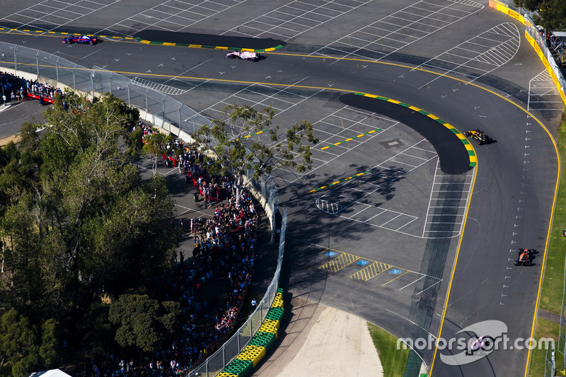 Nico Hulkenberg, Renault Sport F1 Team RS17, leads Fernando Alonso, McLaren MCL32, and Esteban Ocon, Force India VJM10