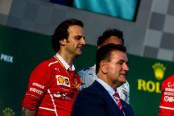 Luigi Fraboni, Head of Power Unit Race Operation, Ferrari, and Alan Jones on the podium