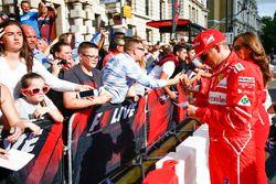 Kimi Raikkonen, Ferrari, meets some fans