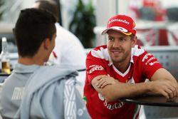(L to R): Pascal Wehrlein, Manor Racing with Sebastian Vettel, Ferrari