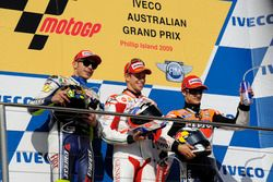 Podium: second place Valentino Rossi, Yamaha; Race winner Casey Stoner, Ducati; third place Dani Ped