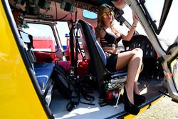 Lovely grid girl pose with an helicopter