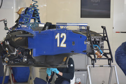 Mechanics working on the Sauber C35