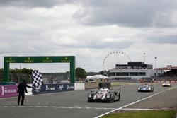 Checkerd flag for the race winner #2 Porsche Team Porsche 919 Hybrid: Romain Dumas, Neel Jani, Marc