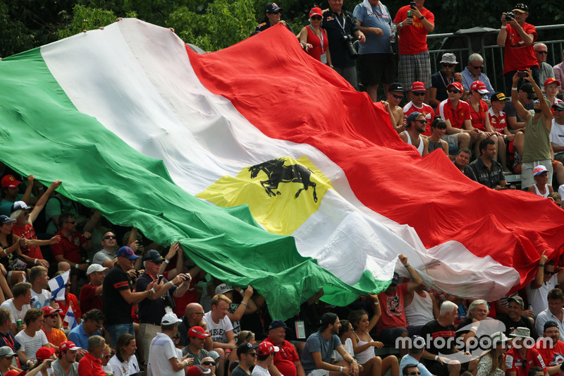 A large Italian flag held by fans in the grandstand