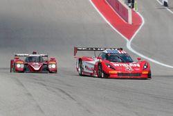 #31 Action Express Racing Corvette DP: Eric Curran, Dane Cameron, #70 Mazda Motorsports Mazda Prototype: Joel Miller, Tom Long