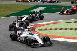 Felipe Massa, Williams FW38 Mercedes, leads Fernando Alonso, McLaren MP4-31 Honda, and Nico Hulkenberg, Force India VJM09 Mercedes
