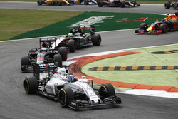 Felipe Massa, Williams FW38 Mercedes, leads Fernando Alonso, McLaren MP4-31 Honda, and Nico Hulkenberg, Force India VJM09 Mercedes