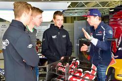 Talenten Richard Verschoor, Danny Kroes en Jarno Opmeer bezoeken Max Verstappen, Scuderia Toro Rosso, op Sochi