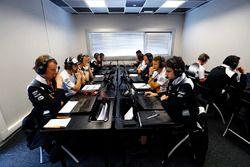 Jenson Button, McLaren and Fernando Alonso, McLaren study data with team members