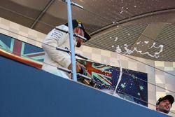 Lewis Hamilton, Mercedes AMG F1 celebrates on the podium with the champagne and Daniel Ricciardo, Re