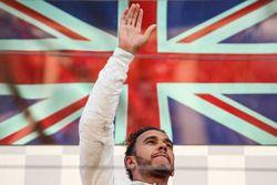 Lewis Hamilton, Mercedes AMG F1 celebrates on the podium and waves