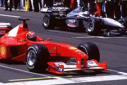 Michael Schumacher, Ferrari and David Coulthard, McLaren