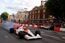 Stoffel Vandoorne, McLaren, takes a McLaren MP4/6 around as Valtteri Bottas, Mercedes AMG F1 W08, di