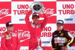 Podium: race winner Alain Prost, McLaren TAG Porsche, second place Michele Alboreto, Ferrari, third