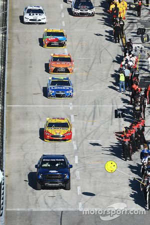 The cars roll off pit road