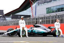 (L to R): Lewis Hamilton, Mercedes AMG F1 with team mate Valtteri Bottas, Mercedes AMG F1 and the Me