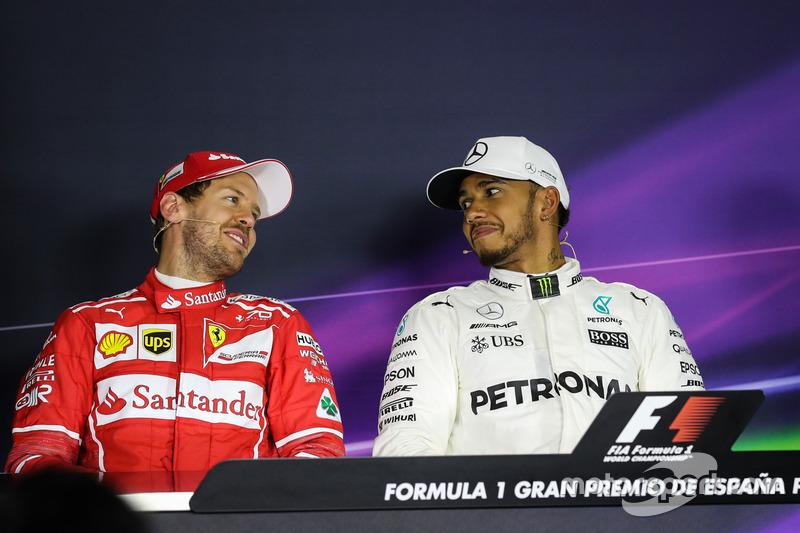 Sebastian Vettel, Ferrari and pole sitter Lewis Hamilton, Mercedes AMG F1 in the Press Conference