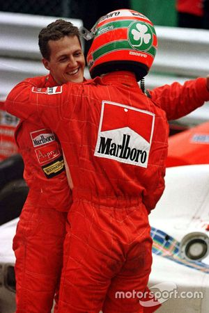 Michael Schumacher, Ferrari and team mate Eddie Irvine, Ferrari