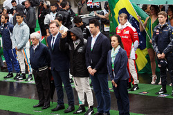 Lewis Hamilton, Mercedes AMG F1 and Bernie Ecclestone, as the grid observes the national anthem