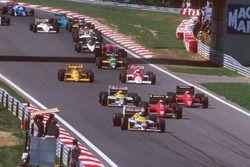 Nigel Mansell, Williams FW11B Honda, leads Gerhard Berger, Ferrari F187, Michele Alboreto, Ferrari F