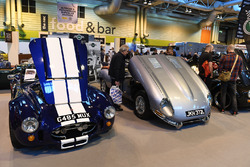 An assortment of classic cars including Ford GT40, AC Cobra and Jaguar E-Type