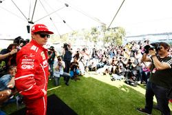 Kimi Raikkonen, Ferrari, poses for photographers