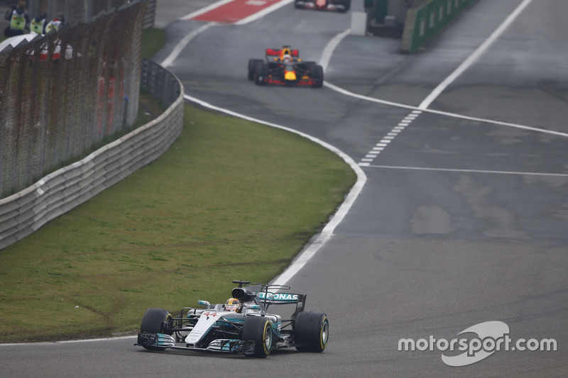 Lewis Hamilton, Mercedes AMG F1 W08, leads Daniel Ricciardo, Red Bull Racing RB13, out of the pits