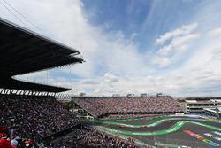 Max Verstappen, Red Bull Racing RB12 leads Sebastian Vettel, Ferrari SF16-H and Daniel Ricciardo, Re
