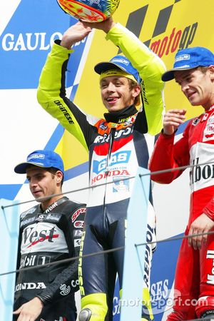 Podium: winner Valentino Rossi, Honda Team, second place Alex Barros, Honda Pons, third place Carlos Checa, Yamaha Team