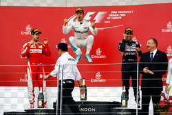 Podium : Sebastian Vettel, Ferrari, deuxième; Nico Rosberg, Mercedes AMG F1, vainqueur; Sergio Perez, Sahara Force India F1, troisième