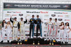 Overall podium: winners Jordan Taylor, Ricky Taylor, second place Christian Fittipaldi, Joao Barbosa, third place Tristan Nunez, Jonathan Bomarito