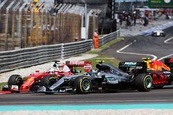 Sebastian Vettel, Ferrari SF16-H, Nico Rosberg, Mercedes AMG F1 W07 Hybrid, and Max Verstappen, Red